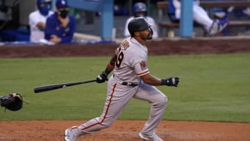 SF Giants right fielder Jaylin Davis (49) follows through on a solo home run in the third inning against the Los Angeles Dodgers at Dodger Stadium. (Kirby Lee-USA TODAY Sports)