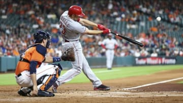 Jun 17, 2016; Houston, TX, USA; Cincinnati Reds left fielder Adam Duvall (23) hits a triple during the second inning against the Houston Astros at Minute Maid Park. Mandatory Credit: Troy Taormina-USA TODAY Sports