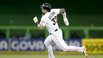 MIAMI, FL - SEPTEMBER 03: Derek Dietrich #32 of the Miami Marlins rounds second base after hitting a triple in the second inning against the Philadelphia Phillies at Marlins Park on September 3, 2018 in Miami, Florida. (Photo by Michael Reaves/Getty Images)