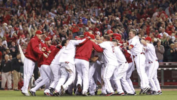 CINCINNATI, OH - SEPTEMBER 28: The Cincinnati Reds celebrate after Jay Bruce's walk off home run in the ninth inning against the Houston Astros at Great American Ball Park on September 28, 2010 in Cincinnati, Ohio. The Reds won 3-2 to clinch the NL Central Division title. (Photo by Joe Robbins/Getty Images)