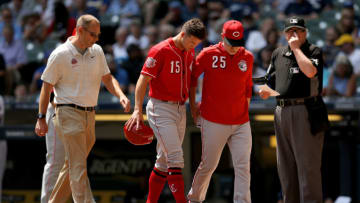 MILWAUKEE, WISCONSIN - JULY 24: Nick Senzel #15 of the Cincinnati Reds leaves the game after being injured in the first inning against the Milwaukee Brewers at Miller Park on July 24, 2019 in Milwaukee, Wisconsin. (Photo by Dylan Buell/Getty Images)