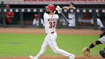 CINCINNATI, OHIO - AUGUST 14: Jesse Winker #33 of the Cincinnati Reds hits a home run (Photo by Andy Lyons/Getty Images)