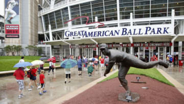 CINCINNATI, OH - JULY 4: Fans walk in the rain past the statue of former Cincinnati Reds pitcher Joe Nuxhall on their way to the game against the San Francisco Giants at Great American Ball Park on July 4, 2013 in Cincinnati, Ohio. (Photo by Joe Robbins/Getty Images)