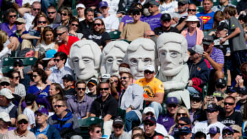 DENVER, CO - JUNE 7: Mascots representing the past Presidents that reside on Mount Rushmore take in a game between the Los Angeles Dodgers and Colorado Rockies at Coors Field on June 7, 2014 in Denver, Colorado. The Rockies defeated the Dodgers 5-4 in 10 innings to end their eight game losing streak. (Photo by Justin Edmonds/Getty Images)