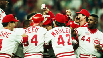 OAKLAND, CA - OCTOBER 20: Eric Davis #44 of the Cincinnati Reds and teammates celebrate their World Series victory. (Photo by Rich Pilling/Getty Images)