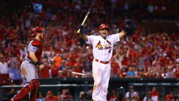 ST. LOUIS, MO - AUGUST 8: Yadier Molina #4 of the St. Louis Cardinals celebrates after being hit by a pitch to drive in the game-winning run against the Cincinnati Reds in the ninth inning at Busch Stadium on August 8, 2016 in St. Louis, Missouri. (Photo by Dilip Vishwanat/Getty Images)