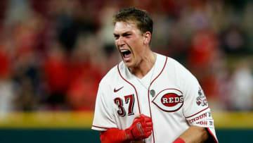 Cincinnati Reds catcher Tyler Stephenson (37) screams as Jonathan India (6) crosses the plate on his game-winning single.