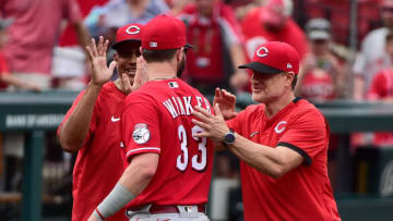 Jun 6, 2021; St. Louis, Missouri, USA; Cincinnati Reds left fielder Jesse Winker (33) celebrates with manager David Bell (25) after the Reds defeated the St. Louis Cardinals. Mandatory Credit: Jeff Curry-USA TODAY Sports