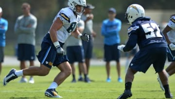 Jul 30, 2016; San Diego, CA, USA; San Diego Chargers tight end Hunter Henry (86) is defended by inside linebacker Denzel Perryman (52) during training camp at Chargers Park. Mandatory Credit: Jake Roth-USA TODAY Sports