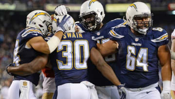 Sep 1, 2016; San Diego, CA, USA; San Diego Chargers fullback Chris Swain (30) is congratulated after scoring on a run during the second quarter against the San Francisco 49ers at Qualcomm Stadium. Mandatory Credit: Jake Roth-USA TODAY Sports