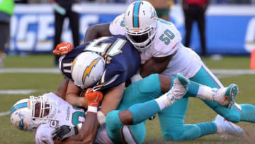 Nov 13, 2016; San Diego, CA, USA; San Diego Chargers quarterback Philip Rivers (17) is sacked by Miami Dolphins defensive end Andre Branch (50) and defensive end Cameron Wake (91) during the second half at Qualcomm Stadium. Miami won 31-24. Mandatory Credit: Orlando Ramirez-USA TODAY Sports