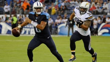 NASHVILLE, TN - AUGUST 13: Manti Te'o #50 of the San Diego Chargers chases quarterback Marcus Mariota #8 of the Tennessee Titans during the first half at Nissan Stadium on August 13, 2016 in Nashville, Tennessee. (Photo by Frederick Breedon/Getty Images)