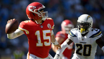 CARSON, CA - SEPTEMBER 09: Patrick Mahomes #15 of the Kansas City Chiefs fends off the rush of Desmond King #20 of the Los Angeles Chargers during the fourth quarter in a 38-28 Chiefs win at StubHub Center on September 9, 2018 in Carson, California. (Photo by Harry How/Getty Images)