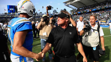 CARSON, CA - OCTOBER 07: Philip Rivers #17 of the Los Angeles Chargers talks with head coach Jon Gruden of the Oakland Raiders after a game at StubHub Center on October 7, 2018 in Carson, California. The Los Angeles Chargers defeated the Oakland Raiders 26-10. (Photo by Sean M. Haffey/Getty Images)