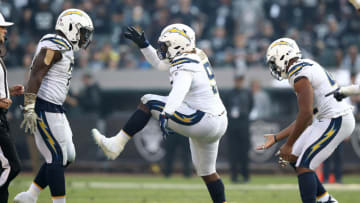 OAKLAND, CA - NOVEMBER 11: Justin Jones #91 of the Los Angeles Chargers celebrates after a play against the Oakland Raiders during their NFL game at Oakland-Alameda County Coliseum on November 11, 2018 in Oakland, California. (Photo by Ezra Shaw/Getty Images)