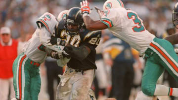8 Jan 1995: SAN DIEGO RUNNING BACK NATRONE MEANS POUNDS THROUGH TWO MIAMI DEFENDERS ON HIS WAY TO A CONTROVERSIAL TOUCHDOWN DURING THE CHARGERS AFC PLAYOFF GAME VERSUS THE DOLPHINS AT JACK MURPHY STADIUM IN SAN DIEGO, CALIFORNIA. THE CHARGERS WENT ON TO W