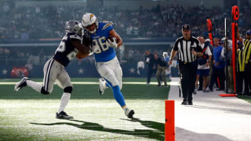 ARLINGTON, TX - NOVEMBER 23: Xavier Woods #25 of the Dallas Cowboys forces Hunter Henry #86 of the Los Angeles Chargers out of bounds in the first half of a football game at AT&T Stadium on November 23, 2017 in Arlington, Texas. (Photo by Wesley Hitt/Getty Images)