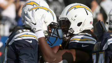 CARSON, CA - DECEMBER 31: Melvin Gordon #28 of the Los Angeles Chargers and Keenan Allen #13 of the Los Angeles Chargers celebrate after scoring a touchdown during the first half of the game against the Oakland Raiders at StubHub Center on December 31, 2017 in Carson, California. (Photo by Stephen Dunn/Getty Images)