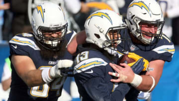 CARSON, CA - DECEMBER 31: Keenan Allen #13 of the Los Angeles Chargers, Derek Watt #34, and Spencer Pulley #73 celebrate after a touchdown during the first half of the game against the Oakland Raiders at StubHub Center on December 31, 2017 in Carson, California. (Photo by Stephen Dunn/Getty Images)