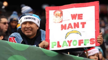 EAST RUTHERFORD, NJ - DECEMBER 24: A Los Angeles Chargers fan holds up a sign during the first half of an NFL game between the New York Jets and the Los Angeles Chargers at MetLife Stadium on December 24, 2017 in East Rutherford, New Jersey. (Photo by Ed Mulholland/Getty Images)