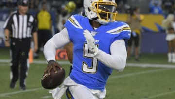 CARSON, CA - AUGUST 24: Tyrod Taylor #5 of the Los Angeles Chargers avoids the Seattle Seahawks during a preseason NFL football game at Dignity Health Sports Park on August 24, 2019 in Carson, California. The Seattle Seahawks won 23-15. (Photo by John McCoy/Getty Images)