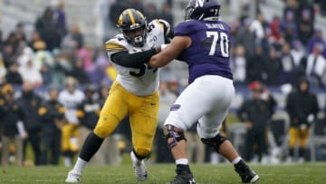 EVANSTON, ILLINOIS - OCTOBER 26: Daviyon Nixon #54 of the Iowa Hawkeyes is blocked by Rashawn Slater #70 of the Northwestern Wildcats at Ryan Field on October 26, 2019 in Evanston, Illinois. (Photo by Justin Casterline/Getty Images)