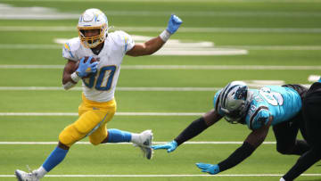 INGLEWOOD, CALIFORNIA - SEPTEMBER 27: Austin Ekeler #30 of the Los Angeles Chargers eludes Marquis Haynes #98 of the Carolina Panthers on a rushing play during the first half of a game at SoFi Stadium on September 27, 2020 in Inglewood, California. (Photo by Sean M. Haffey/Getty Images)