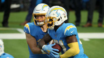 INGLEWOOD, CALIFORNIA - NOVEMBER 22: Justin Herbert #10 of the Los Angeles Chargers hands the ball off to Kalen Ballage #31 during the first quarter against the New York Jets at SoFi Stadium on November 22, 2020 in Inglewood, California. (Photo by Katelyn Mulcahy/Getty Images)
