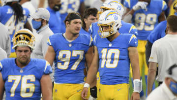 INGLEWOOD, CALIFORNIA - DECEMBER 06: Defensive end Joey Bosa #97 and quarterback Justin Herbert #10 of the Los Angeles Chargers talk on the field after the game at SoFi Stadium on December 06, 2020 in Inglewood, California. The Patriots defeated the Chargers 45-0. (Photo by Harry How/Getty Images)