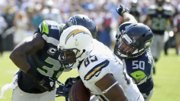 SAN DIEGO, CA - SEPTEMBER 14: Tight end Antonio Gates #85 of the San Diego Chargers scores a touchdown while defended by strong safety Kam Chancellor #31 and outside linebacker K.J. Wright #50 of the Seattle Seahawks at Qualcomm Stadium on September 14, 2014 in San Diego, California. (Photo by Harry How/Getty Images)
