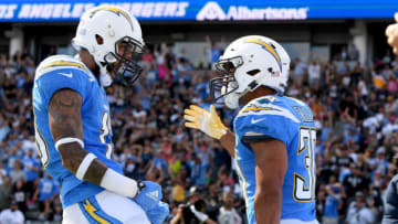 Austin Ekeler #30 of the Los Angeles Chargers celebrates his touchdown with Keenan Allen #13 (Photo by Harry How/Getty Images)
