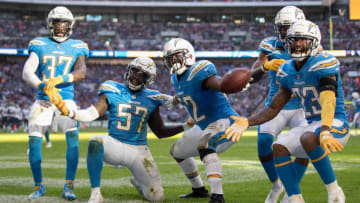 LONDON, ENGLAND - OCTOBER 21: Denzel Perryman of Los Angeles Chargers and team mates celebrate his interception during the NFL International Series match between Tennessee Titans and Los Angeles Chargers at Wembley Stadium on October 21, 2018 in London, England. (Photo by Clive Rose/Getty Images)