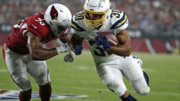 GLENDALE, ARIZONA - AUGUST 08: Austin Ekeler #30 of the Los Angeles Chargers runs the ball as Rudy Ford #30 of the Arizona Cardinals attempts to make the tackle during the first half of the NFL pre-season game at State Farm Stadium on August 08, 2019 in Glendale, Arizona. (Photo by Ralph Freso/Getty Images)