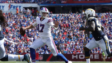 BUFFALO, NY - SEPTEMBER 16: Josh Allen #17 of the Buffalo Bills tries to get away from Melvin Ingram III #54 of the Los Angeles Chargers during NFL game action against the Los Angeles Chargers at New Era Field on September 16, 2018 in Buffalo, New York. (Photo by Tom Szczerbowski/Getty Images)