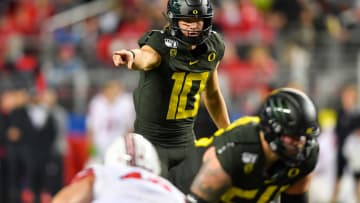 SANTA CLARA, CALIFORNIA - DECEMBER 06: Justin Herbert #10 of the Oregon Ducks directs the offense during the second quarter of the Pac-12 Championship football game against the Utah Utes at Levi's Stadium on December 6, 2019 in Santa Clara, California. The Oregon Ducks won 37-15. (Alika Jenner/Getty Images)