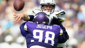 Linval Joseph #98 of the Minnesota Vikings hits quarterback Kellen Clemens #10 of the San Diego Chargers (Photo by Hannah Foslien/Getty Images)