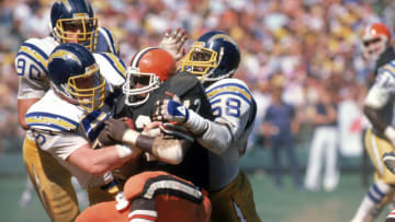 Fullback Mike Pruitt #43 of the Cleveland Browns taken down by linebackers Linden King #57 and Mike Green #58 of the San Diego Chargers (Photo by George Rose/Getty Images)