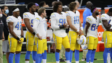 NEW ORLEANS, LOUISIANA - OCTOBER 12: The Los Angeles Chargers stand on the field prior to their NFL game against the New Orleans Saints at Mercedes-Benz Superdome on October 12, 2020 in New Orleans, Louisiana. (Photo by Chris Graythen/Getty Images)