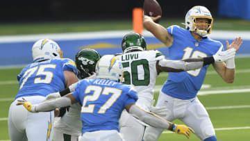 INGLEWOOD, CALIFORNIA - NOVEMBER 22: Justin Herbert #10 of the Los Angeles Chargers throws a pass during the first half against the New York Jets at SoFi Stadium on November 22, 2020 in Inglewood, California. (Photo by Kevork Djansezian/Getty Images)