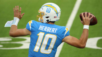 INGLEWOOD, CALIFORNIA - DECEMBER 06: Quarterback Justin Herbert #10 of the Los Angeles Chargers motions to pass the ball in the first half of the game against the New England Patriots at SoFi Stadium on December 06, 2020 in Inglewood, California. (Photo by Katelyn Mulcahy/Getty Images)