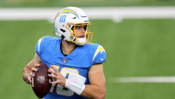 INGLEWOOD, CALIFORNIA - DECEMBER 27: Justin Herbert #10 of the Los Angeles Chargers looks to pass during the first half of a game against the Denver Broncos at SoFi Stadium on December 27, 2020 in Inglewood, California. (Photo by Sean M. Haffey/Getty Images)