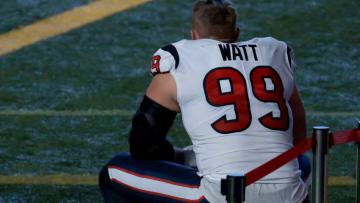 INDIANAPOLIS, INDIANA - DECEMBER 20: J.J. Watt #99 of the Houston Texans sits on the sidelines before the game against the Indianapolis Colts at Lucas Oil Stadium on December 20, 2020 in Indianapolis, Indiana. (Photo by Justin Casterline/Getty Images)