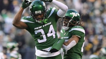 EAST RUTHERFORD, NEW JERSEY - DECEMBER 22: Brian Poole #34 and Darryl Roberts #27 of the New York Jets celebrate after a turnover on downs as their teams defeats the Pittsburgh Steelers 16-10 at MetLife Stadium on December 22, 2019 in East Rutherford, New Jersey. (Photo by Steven Ryan/Getty Images)