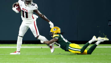 GREEN BAY, WISCONSIN - OCTOBER 05: Kevin King #20 of the Green Bay Packers attempts to tackle Julio Jones #11 of the Atlanta Falcons during the first half at Lambeau Field on October 05, 2020 in Green Bay, Wisconsin. (Photo by Dylan Buell/Getty Images)