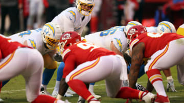 KANSAS CITY, MISSOURI - JANUARY 03: Quarterback Justin Herbert #10 of the Los Angeles Chargers takes the snap during the game against the Kansas City Chiefs at Arrowhead Stadium on January 03, 2021 in Kansas City, Missouri. (Photo by Jamie Squire/Getty Images)