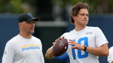 Jun 7, 2021; Costa Mesa, CA, USA; Los Angeles Chargers quarterback Justin Herbert (10) throws a pass under the supervision of offensive coordinator Joe Lombardi during organized team activities at the Hoag Performance Center. Mandatory Credit: Kirby Lee-USA TODAY Sports