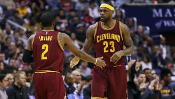 Feb 20, 2015; Washington, DC, USA; Cleveland Cavaliers forward LeBron James (23) celebrates with guard Kyrie Irving (2) against the Washington Wizards in the third quarter at Verizon Center. The Cavaliers won 127-89. Mandatory Credit: Geoff Burke-USA TODAY Sports
