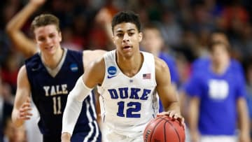 Mar 19, 2016; Providence, RI, USA; Duke Blue Devils guard Derryck Thornton (12) brings the ball up court against the Yale Bulldogs during the first half of a second round game of the 2016 NCAA Tournament at Dunkin Donuts Center. Mandatory Credit: Mark L. Baer-USA TODAY Sports