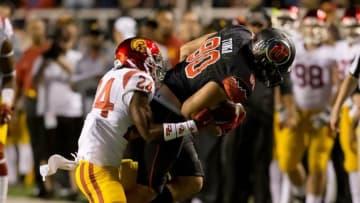 Oct 25, 2014; Salt Lake City, UT, USA; USC Trojans safety John Plattenburg (24) tackles Utah Utes tight end Westlee Tonga (80) during the first half at Rice-Eccles Stadium. Mandatory Credit: Russ Isabella-USA TODAY Sports
