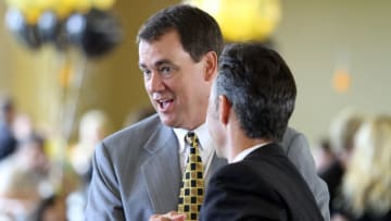 BOULDER, CO - JUNE 11: University of Colorado Athletic Director Mike Bohn (L) is congratulated by Regent Tom Lucero before the University of Colorado Board of Regents at Folsom Stadium on June 11, 2010 in Boulder, Colorado. The university's board of regents voted unanimously to accept an invitation to join the PAC-10 Conference. (Photo by Marc Piscotty/Getty Images)
